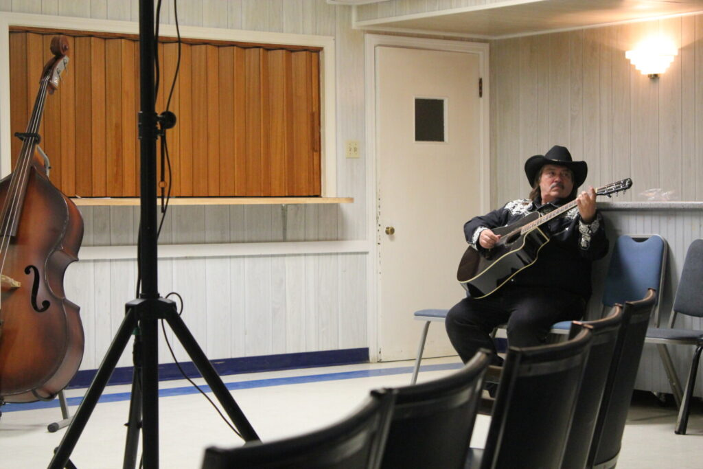 "Jeff Simon, one of the state's country music hall of fame inductees, warms up on the guitar before a performance for a live taping of ""Maine's Down Home Country Jamboree"" Sunday night at the old Waterville Legion building on College Avenue. Simon used to perform on ""Dick Stacey's Country Jamboree,"" which the new show is based off of, in the 1970s and '80s."