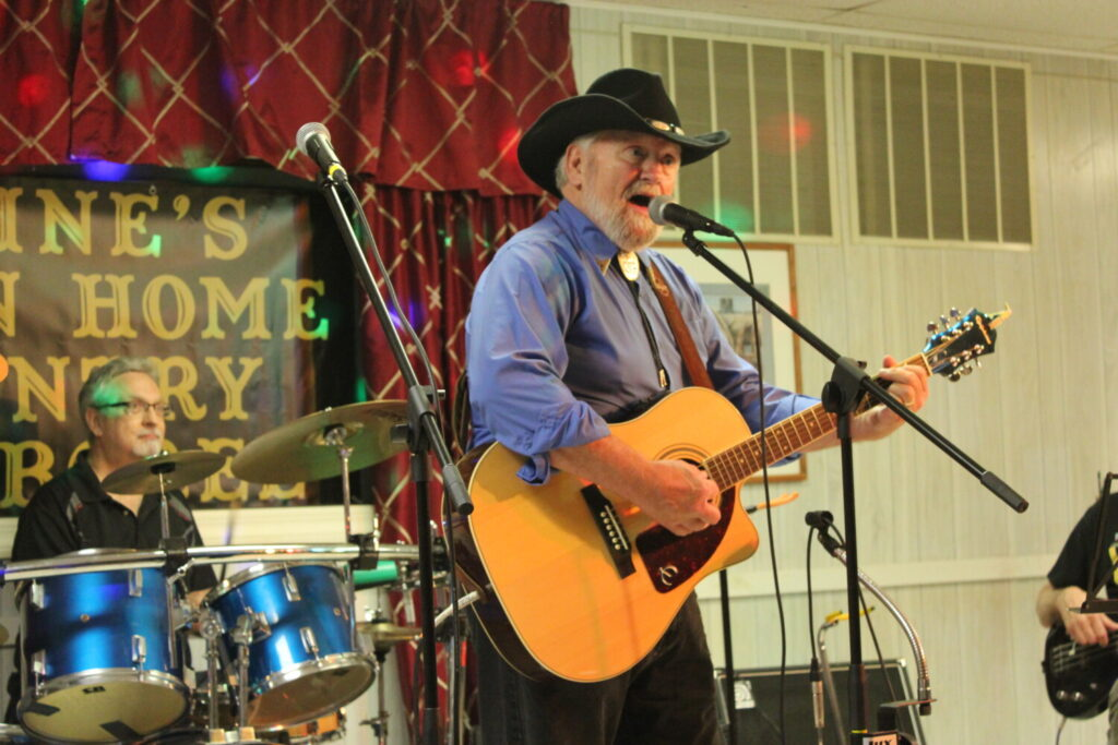 "Bob Heller, center, host of ""Maine's Down Home Country Jamboree,"" performs a traditional country song during a taping of the new Fox 22 show Sunday night at 21 College Ave. in Waterville."