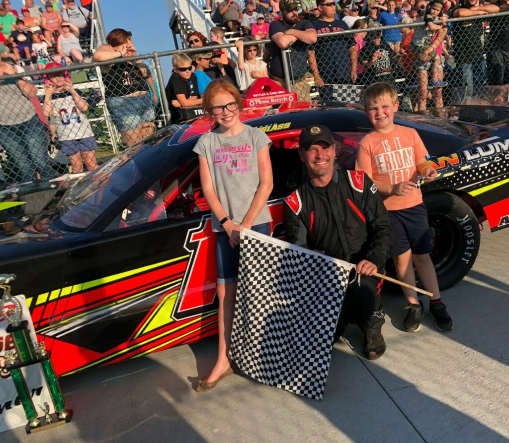 Kevin Douglass of Sidney, center, celebrates his Pro Stock win on Saturday in victory lane at Wiscasset Speedway.