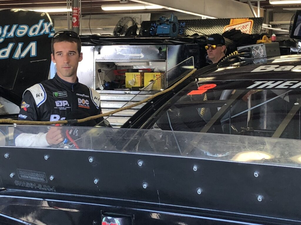 Austin Theriault of Fort Kent looks on at activity in the garage area during Monster Energy NASCAR Cup Series practice Friday at New Hampshire Motor Speedway in Loudon, New Hampshire.