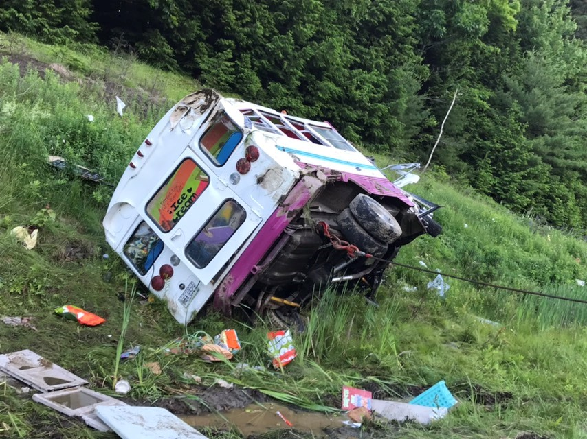 A bus that had been converted into an ice cream truck went off the road following a crash while it was traveling north on Interstate 295 in Bowdoinham on Monday.