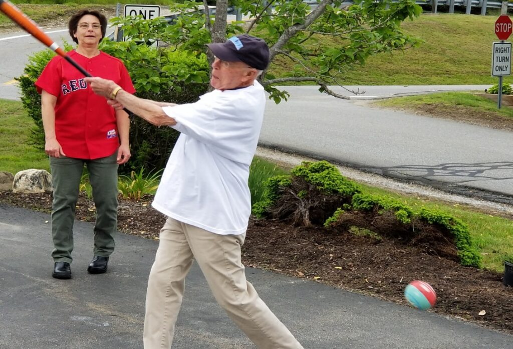 Julie Adams, chef at Lincoln Home in Newcastle, cheers on Phil Cameron, 90, during the 14th annual baseball game.