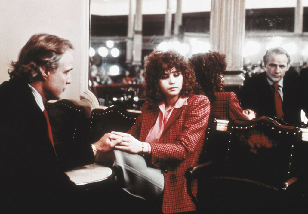 "Marlon Brando and Maria Schneider appear in a scene in the 1972 film ""Last Tango in Paris."""