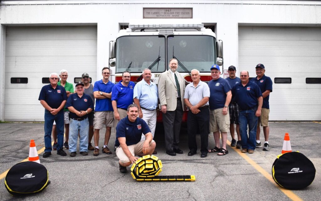 The Masons of Monmouth Lodge 110 recently met with members of the Monmouth Fire Department to present four portable speed bumps to the firefighters. From left are Assistant Chief Ed Pollard, Jimmy Price, Assistant Chief Pat Smith, Ed Garnier, Lt. Ron Cook (Mason), Senior Warden Mike Clinton (Mason), Tony Perkins (Mason), Most Worshipful David Walker (Mason), Worshipful Master David Stevens (Mason), Hugh LeMaster (Mason), Luke Boucher (Mason), Lt. Lance Reny (Mason), Assistant and Chief Ken Palleschi. Fire Chief Dan Roy (Mason) is kneeling in front.