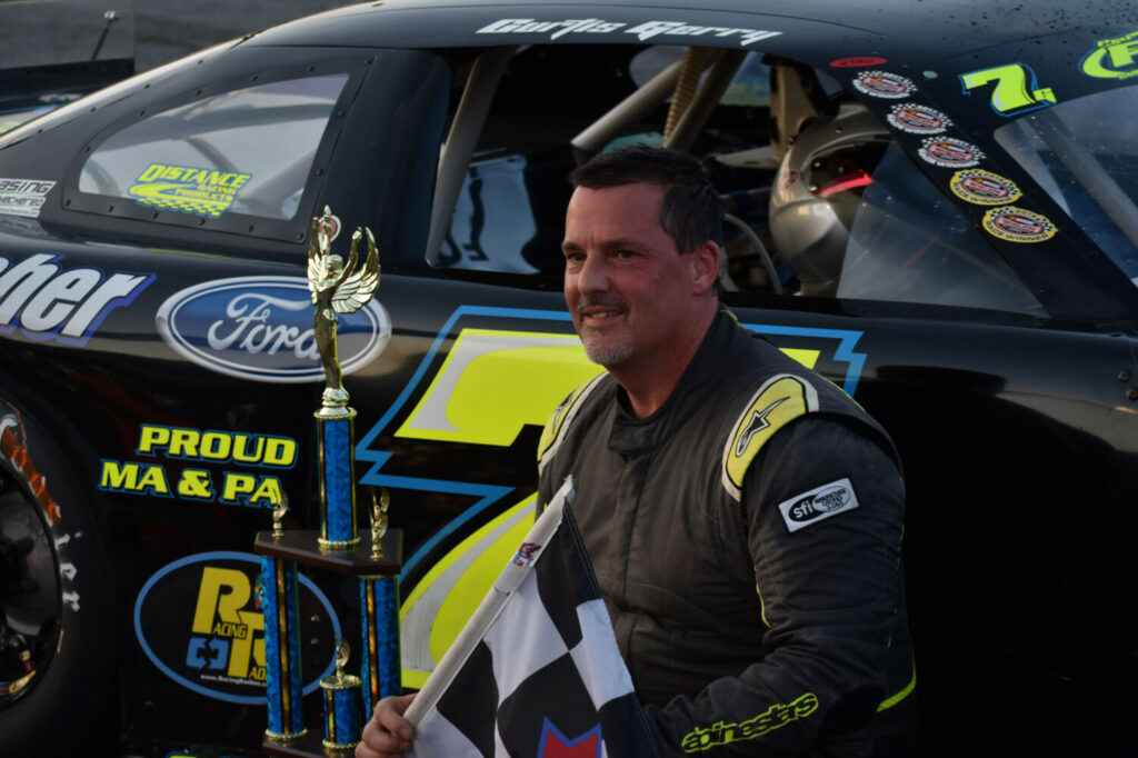 Curtis Gerry celebrates his victory in the PASS 150 race at Oxford Plains Speedway in July.
