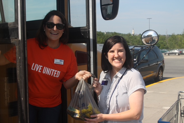 United Way of Mid-Maine Rising Leaders Samantha Burdick, left, and Elizabeth Llewellyn Stuff the Bus at last year's event.