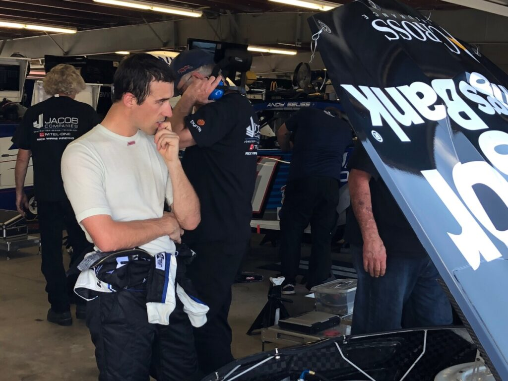 Austin Theriault looks over his No. 52 Bangor Savings Bank Chevrolet following final practice for the Foxwoods Resort Casino 301 on Saturday at New Hampshire Motor Speedway in Loudon, N.H.