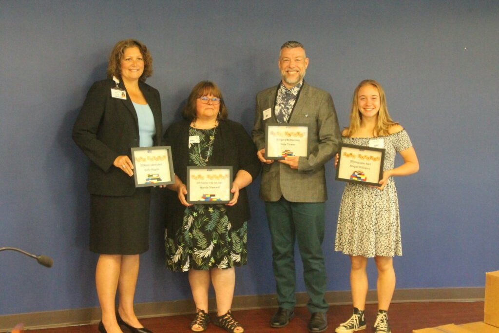 The United Way of Mid-Maine has announced its Community Impact Award recipients. From left are Buffy Higgins, Wanda Steward, Nate Towne and Abigail Williams.