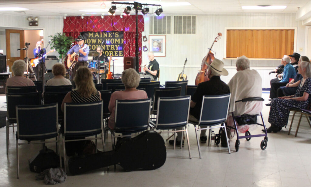 "Waterville-area residents listen to host Bob Heller perform traditional country music during a live taping of ""Maine's Down Home Country Jamboree"" at the old Legion building on College Avenue Sunday night."