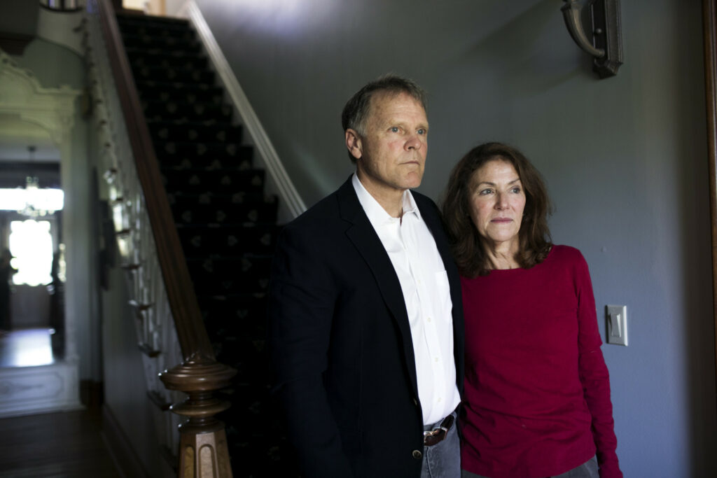 Fred and Cindy Warmbier stand in their home in Wyoming, Ohio, in April 2017. The couple are seeking North Korean assets to recover what they can for the loss of their son, Otto Warmbier, a University of Virginia student who died in 2016.