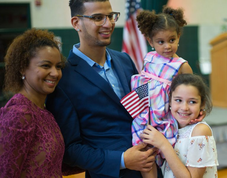 Luis Sanchez of Saco poses with his wife, Raimy Sanchez Constantine, and daughters Sophia Sanchez and Julia Constantine, right, after becoming a U.S. citizen last November.