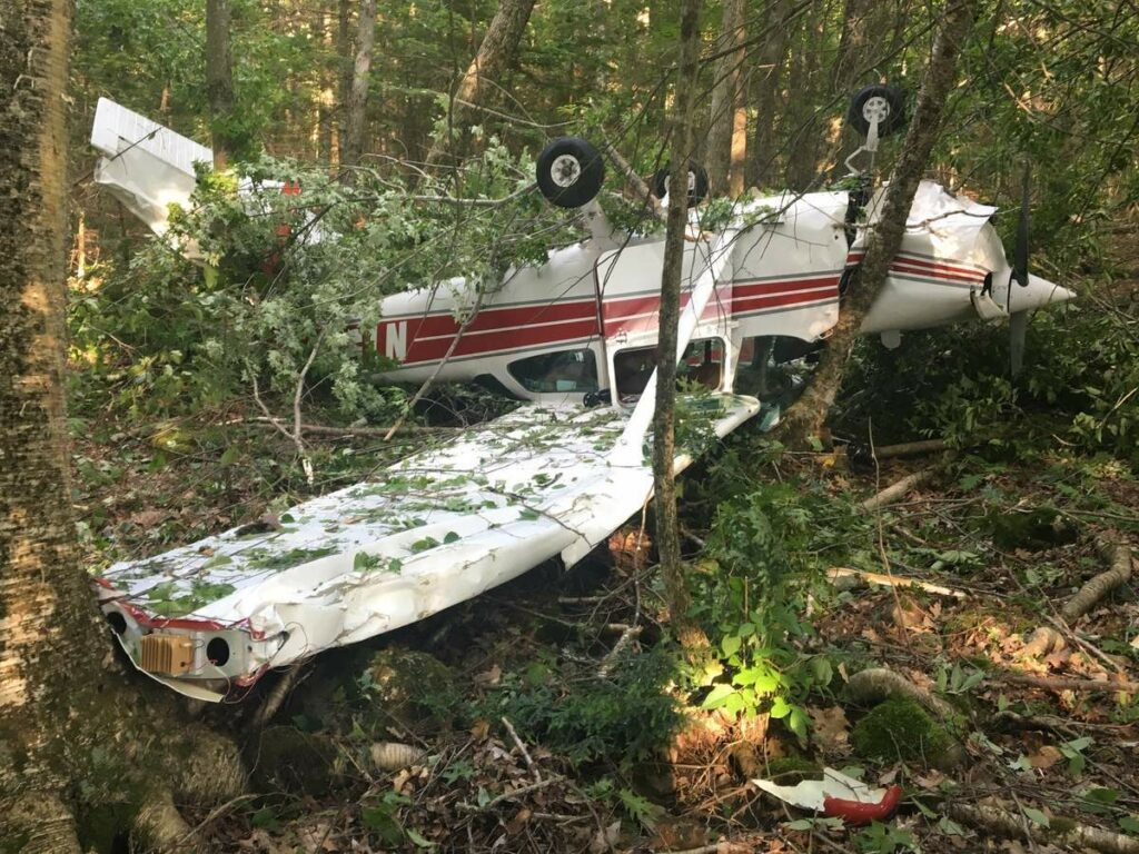Aircraft wreckage lies in Hidden Valley Camp woods in Montville after a crash July 3 that injured the plane's three occupants.