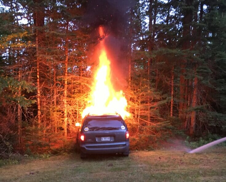 Skowhegan police investigated this van fire Tuesday on Malbon Mills Road in Skowhegan. Two people were arrested later in connection with the fire and theft of the van.