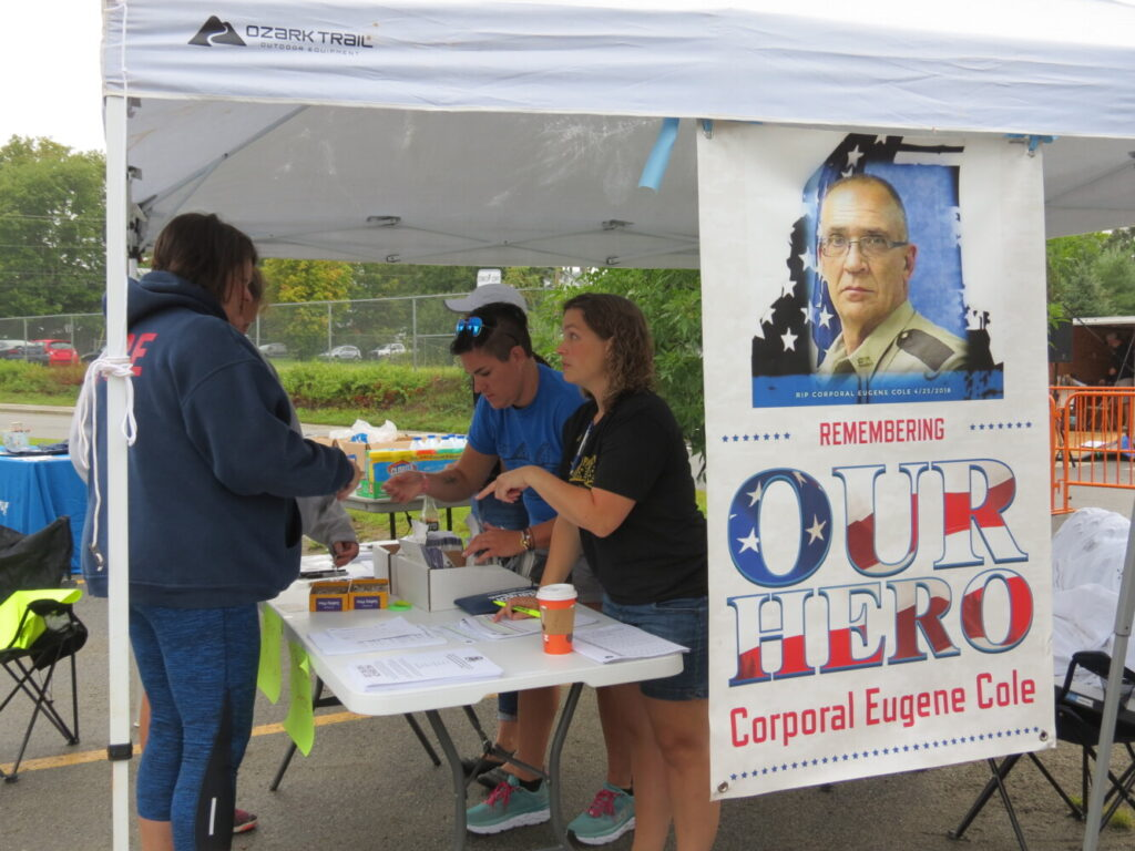 Theresa Howard, a planning committee member for the Corporal Cole Memorial 5K and Half Marathon, registers participants Sunday.