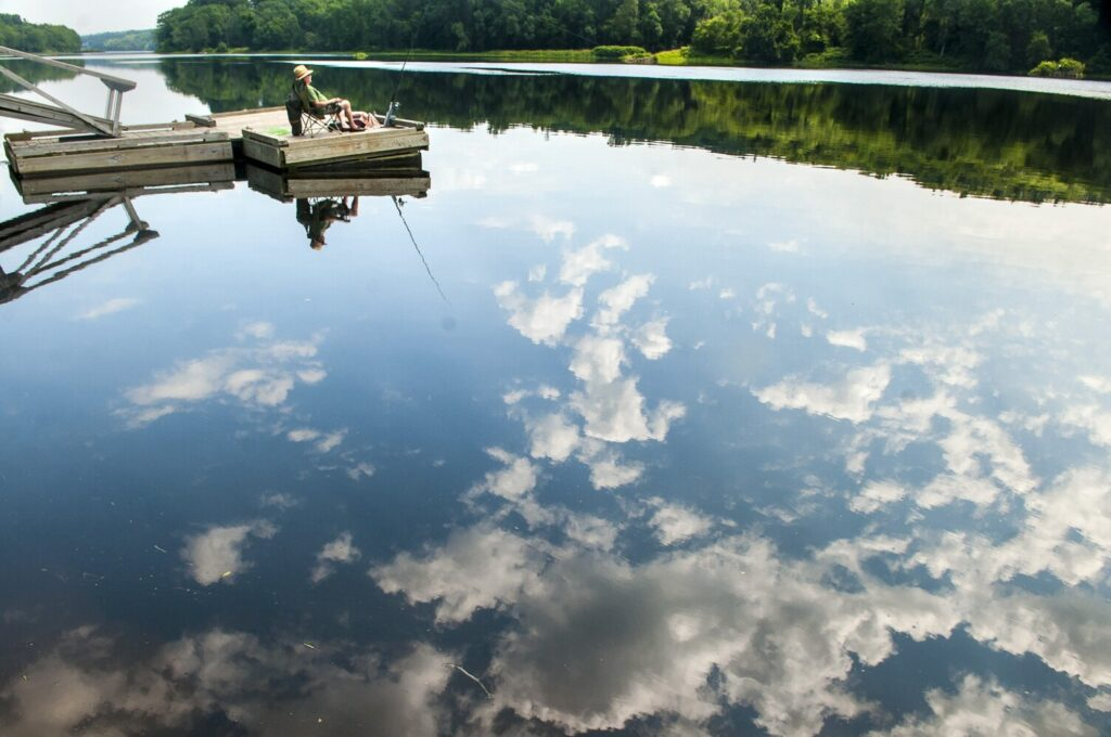 Albert Barter, of Skowhegan, waits for a striped bass to strike his line on July 20, 2017, at the state boat launch in Hallowell.