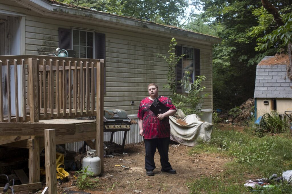 Zachary Beggs, 17, photographed with his school laptop outside his home in New Gloucester, has been a student in Maine Virtual Academy since his freshman year of high school. Beggs, who's now going into his senior year, said he enjoys the online charter school much more than traditional school.