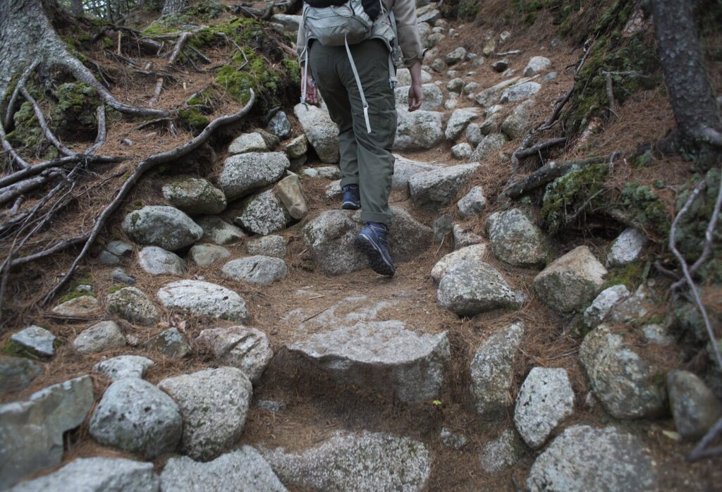 Baxter State Park Trail Supervisor Liz Thibault hikes up a 450-step stone staircase on the Hunt Trail up Mt. Katahdin. The staircase took over a decade to install.