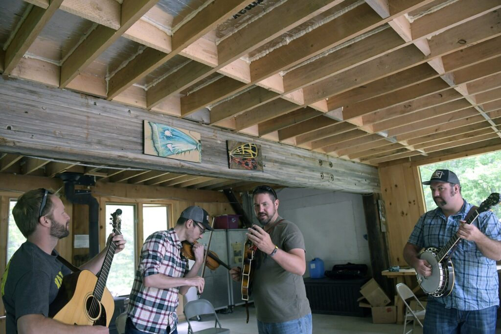 The band Tricky Britches tunes up Sunday before performing at the Hidden Valley Nature Center in Jefferson.