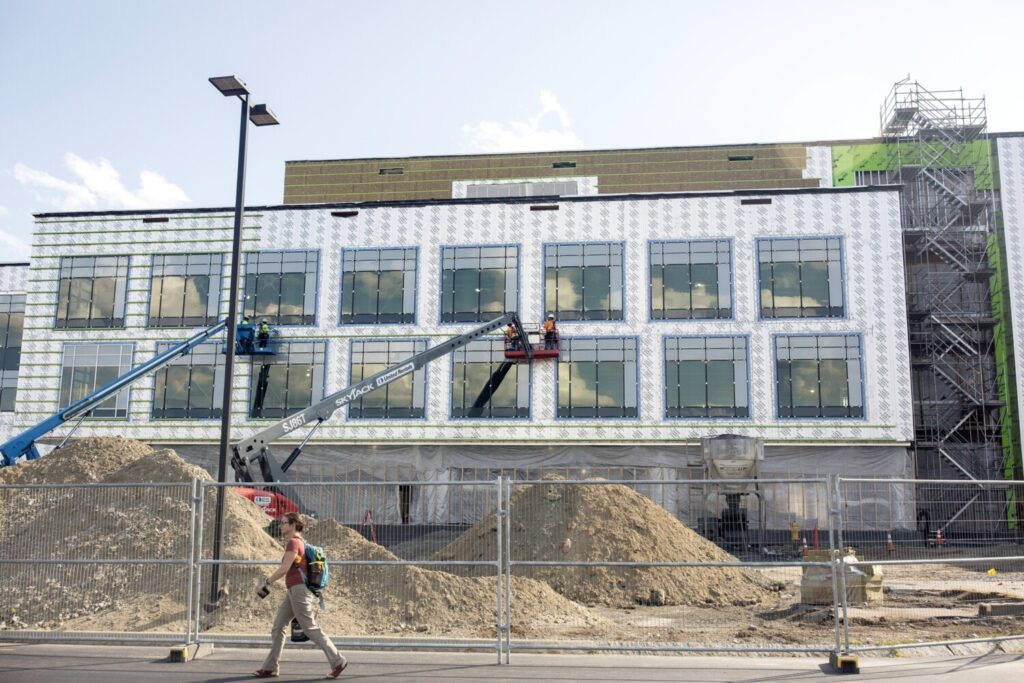 Construction continues on Idexx's headquarters expansion project in Westbrook as employees leave work in early August. The company could potentially tap a $16 million corporate tax break if it adds 80 new employees a year for 10 years.
