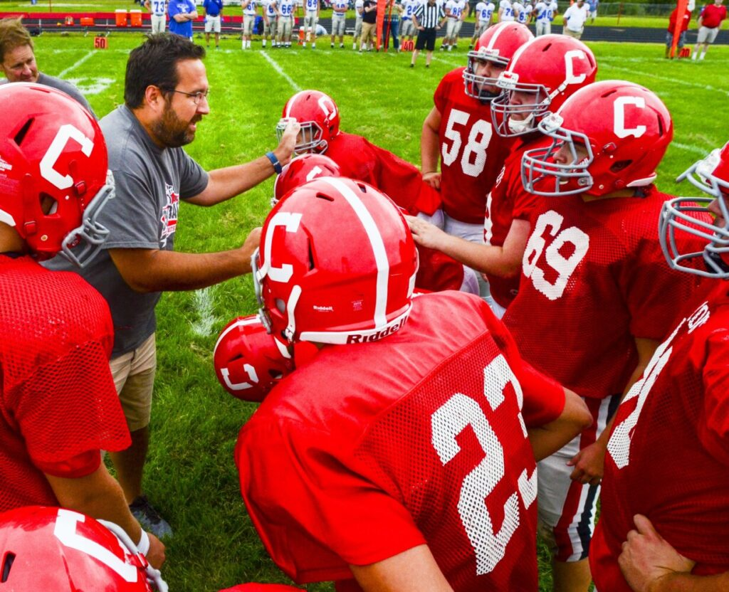 Cony football coach B.L. Lippert calls an offensive play during a scrimmage against Lawrence on Aug. 24, 2019 at Alumni Field in Augusta.