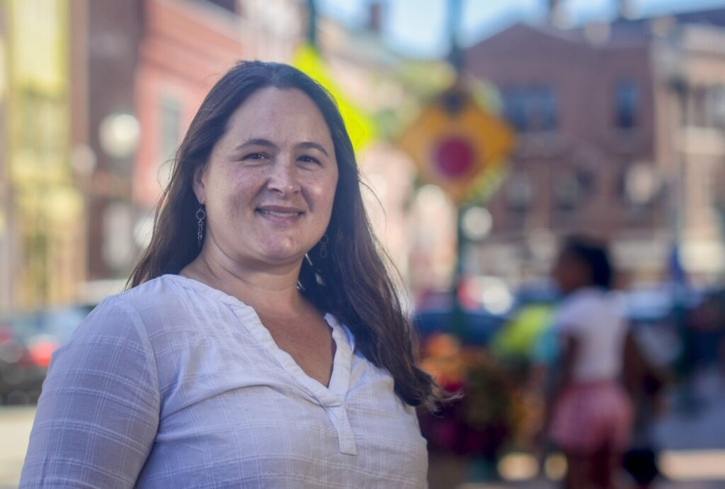 Melissa Lindley, who was recently named as new executive director of Gardiner Main Street, poses Tuesday along Water Street in downtown Gardiner.