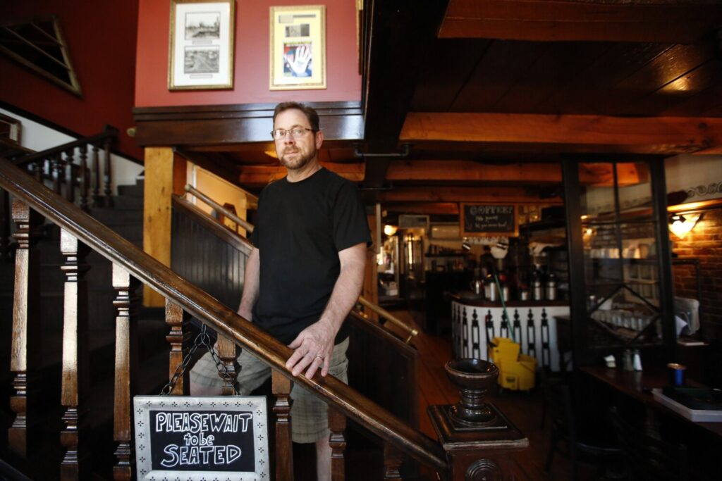 Joe Catoggio, owner of Bayside American Cafe, which was burglarized in the early morning hours Tuesday, is most upset about the damage to an antique safe and the unique hand painting on its door.