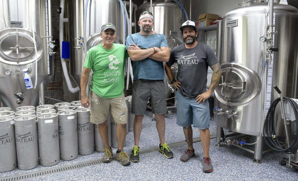 Partners Steve Casey, Jim Swain and Matt Kendall take a break Thursday at Bateau Brewing in Gardiner. The tasting room opened to customers on Saturday.