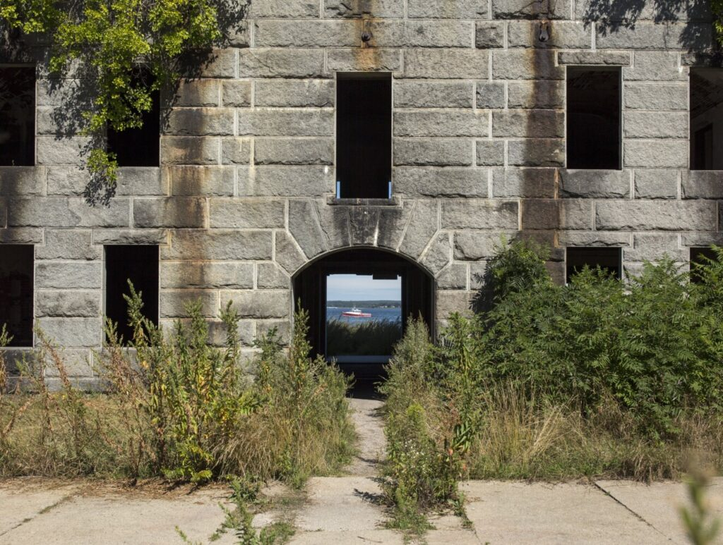 A passing lobster boat appears through the frame of the front gate at Fort Gorges on Aug. 30.