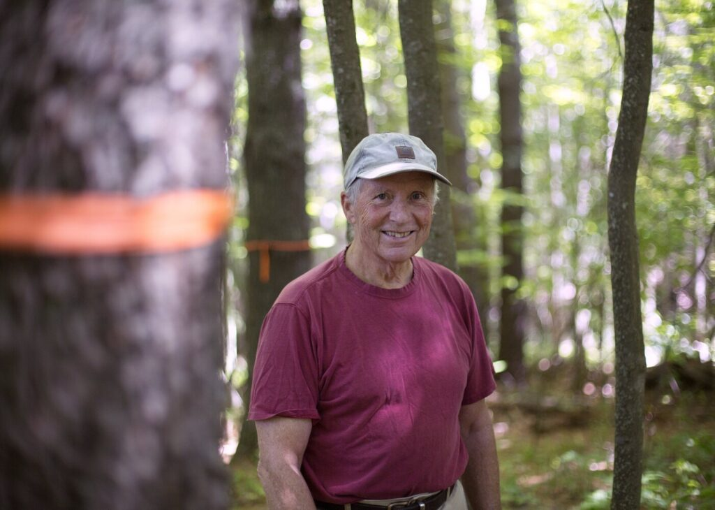 Denny Gallaudet has been harvesting his woodlot in Cumberland for 40 years, mostly for firewood to heat his home, but has changed his management techniques to reduce carbon loss from the carbon-rich soil and carbon-banking trees.