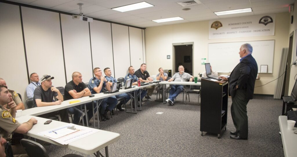 Mike Sielicki, regional director of Kologik, presents Campus Safe training Wednesday for an active shooter situation to law enforcement officials from multiple state and federal agencies at the Somerset County sheriff's department in Madison.