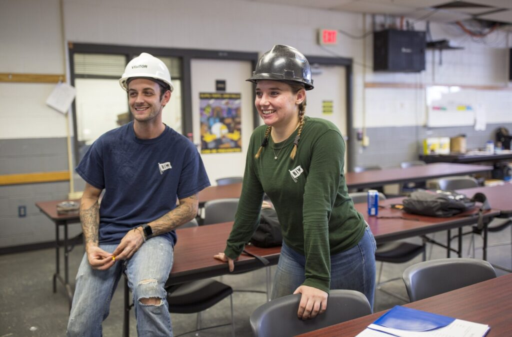 Ryan Morse, 26, left, and Miranda Shaubhut, 22, inside one of the classrooms at the Bath Iron Works training facility at Brunswick Landing. Both went through the BIW training facility. Now Morse is working as a shipfitter and Shaubhut as a welder.