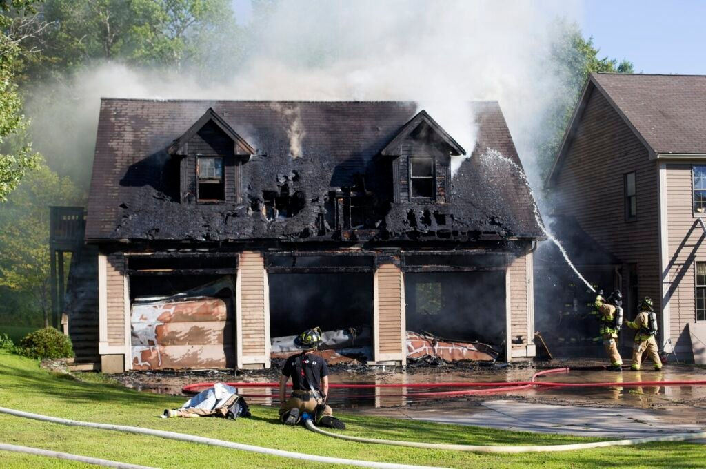 Firefighters from eight departments responded to a fire that started in a garage and spread to an attached house at 8 Foothill Lane in Sanford on Thursday.