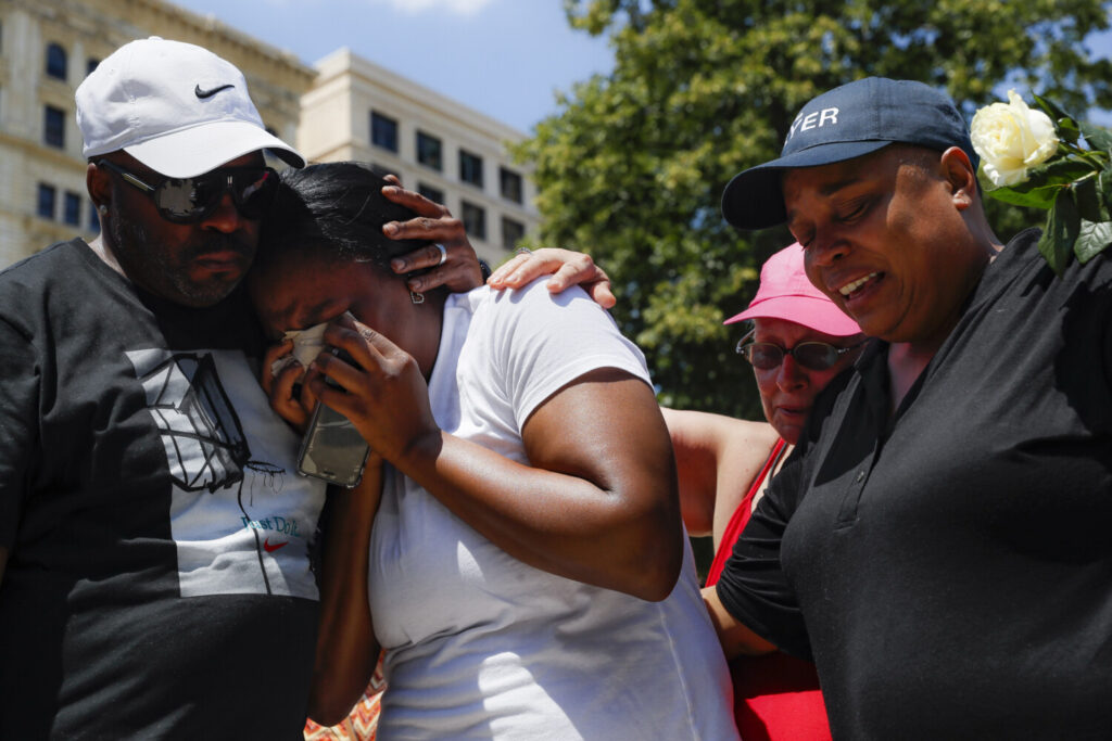 Mourners gather at a vigil after a mass shooting on Sunday in Dayton, Ohio.