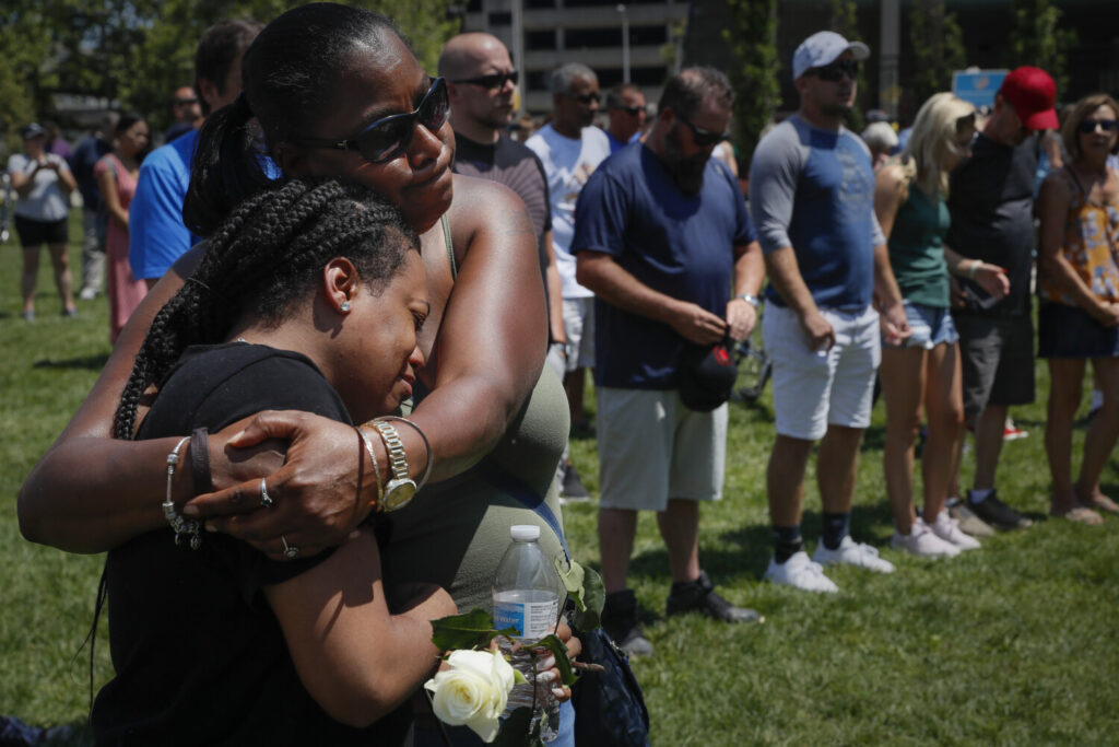 Mourners gather at a vigil after a mass shooting  Sunday in Dayton, Ohio.   John Minchillo/Associated Press)