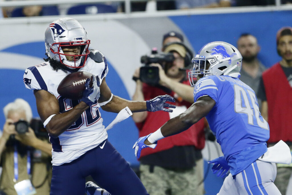 "Maurice Harris makes a one-handed grab for a touchdown in the Patriots' 31-3 preseason win over the Detroit Lions. Harris is known for his ""unbelievable hands."""