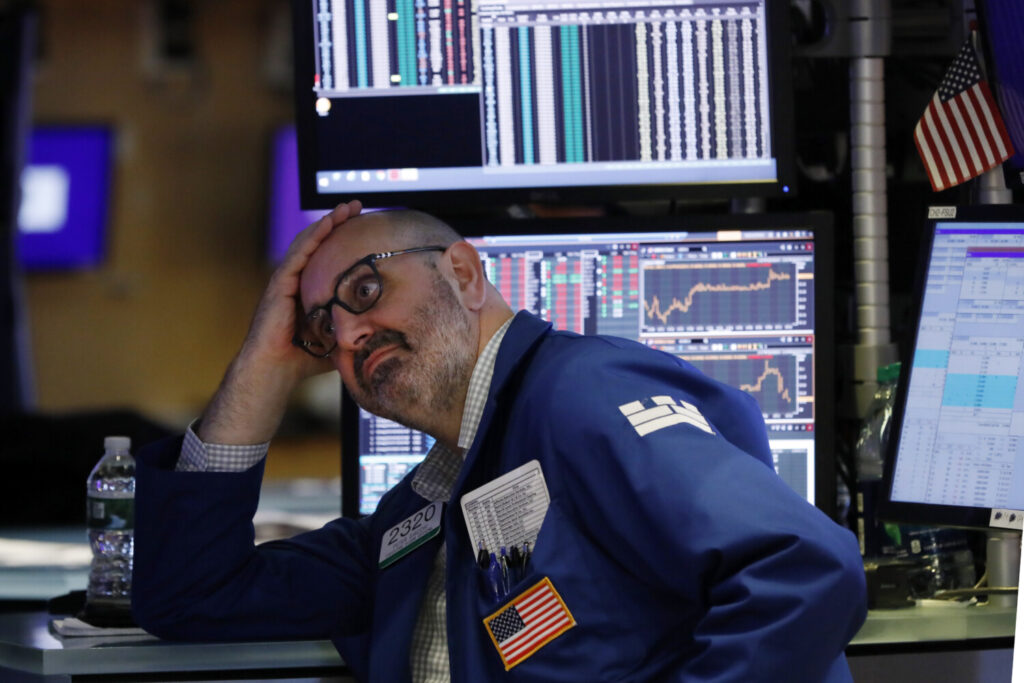 "Specialist Peter Giacchi works on the floor of the New York Stock Exchange on Friday, when stocks tumbled after President Trump said he ""hereby ordered"" U.S. companies to consider alternatives to doing business in China."
