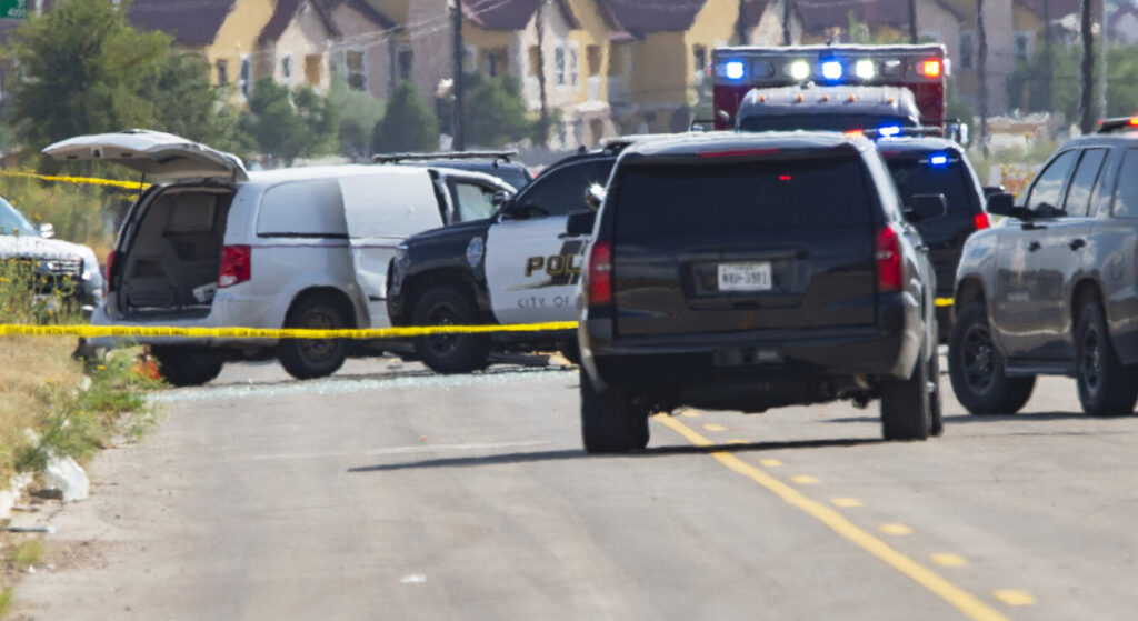 Odessa and Midland police and sheriff's deputies surround a white van in Odessa, Texas, on Saturday.