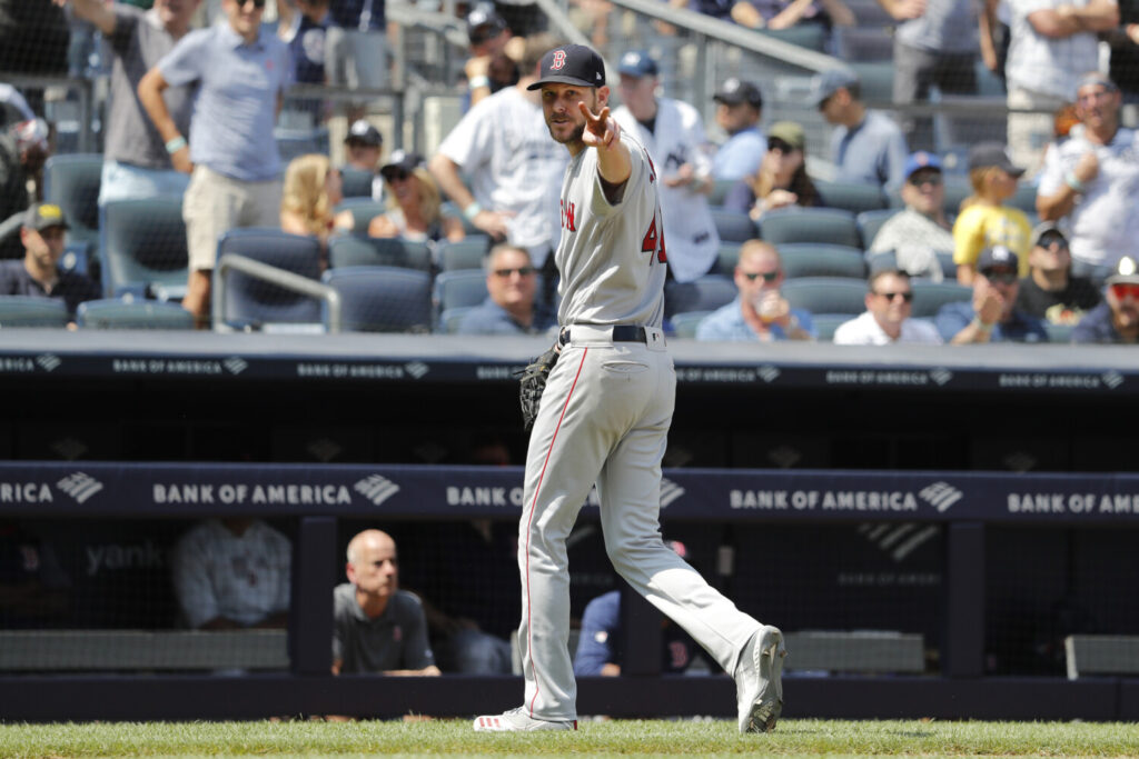 Boston Red Sox pitcher Chris Sale yells at home plate umpire Mike Estabrook as he leaves the game after allowing eight runs in 3 2/3 innings in a 9-3 loss to the New York Yankees on Sunday in New York.