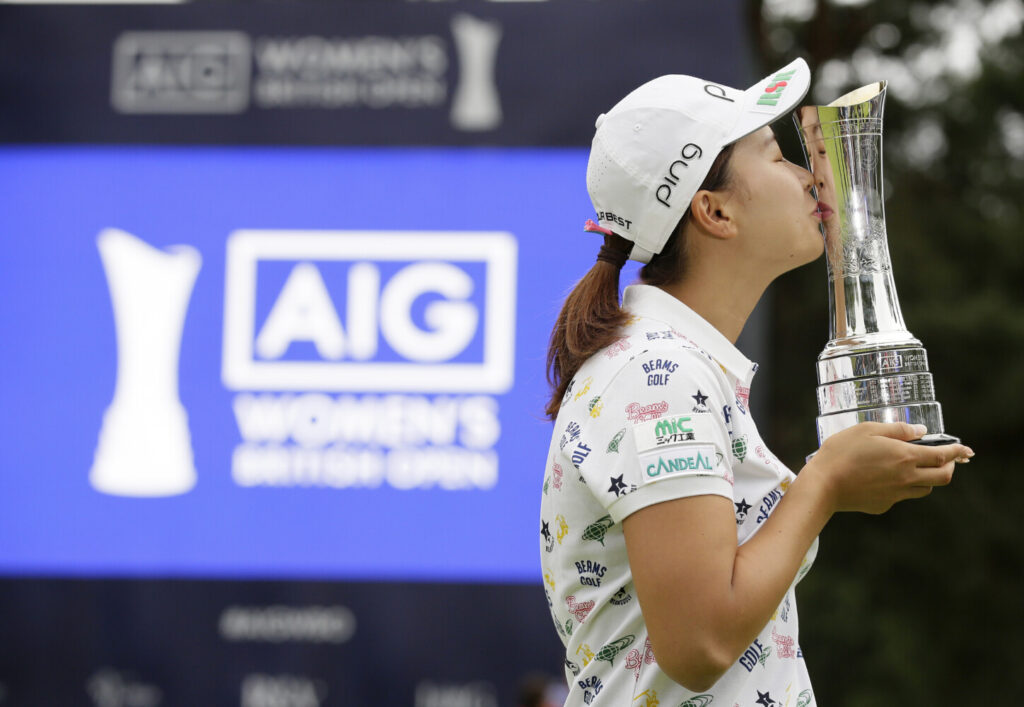 Hinako Shibuno kisses the trophy as she celebrates after winning the Women's British Open on Sunday at Woburn Gold Club near near Milton Keynes, England.