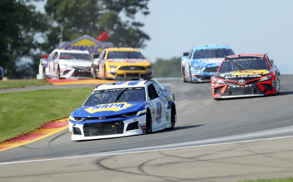 Chase Elliott held off Martin Truex Jr. to win the NASCAR Cup series race at Watkins Glen for the second straight year.