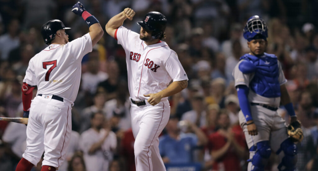 Sam Travis, right, celebrates with Christian Vazquez after hitting a two-run home run in the third inning of Boston's 7-5 win over the Kansas City Royals on Monday at Fenway Park.