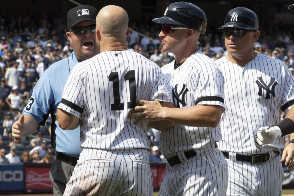 Brett Gardner, 11, argues with third base umpire Todd Tichenor after being ejected in the sixth inning of the Yankees' 6-5 win over the Cleveland Indians on Saturday in New York. Pitcher CC Sabathia and Manager Aaron Boone were also ejected.
