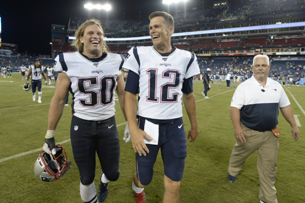 Tom Brady, right, did not play in the Patriots' 22-17 win over the Titans on Saturday, but rookie defensive lineman Chase Winovich did and he continues to be impressive.