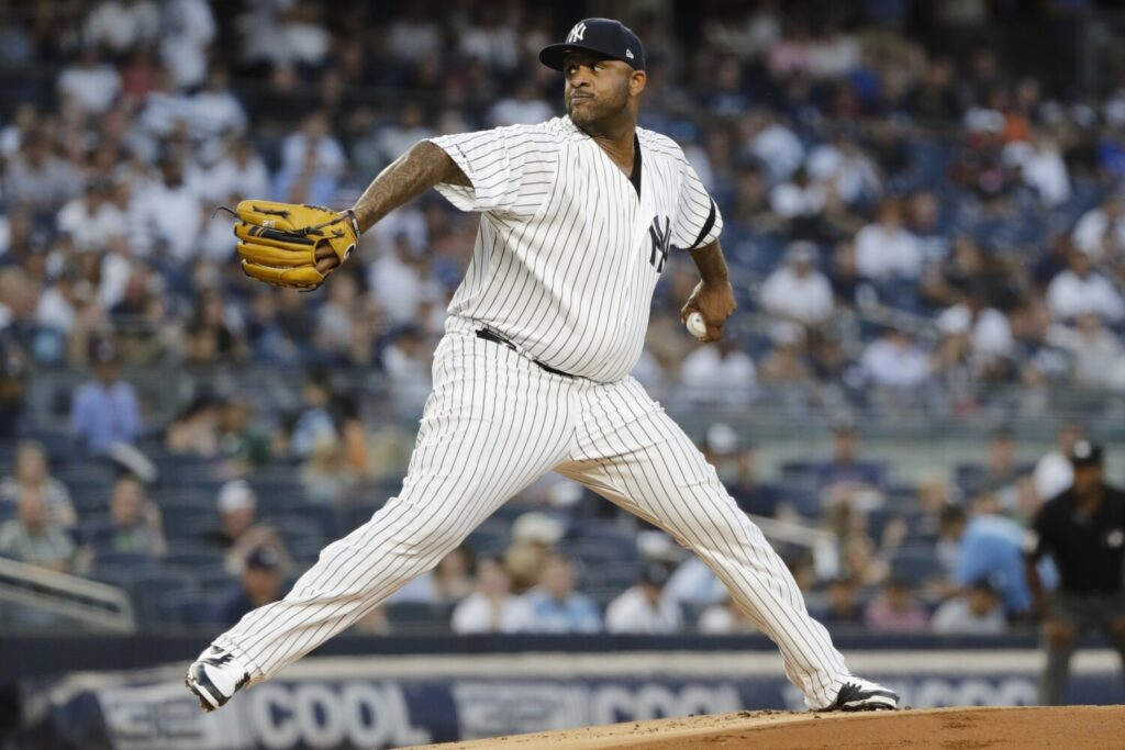 CC Sabathia was placed on the disabled list by the New York Yankees with right-knee soreness.