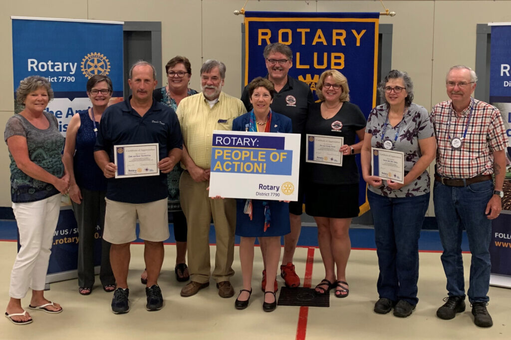 Gardiner Rotary recently honored three local business for outstanding community service. From left are Paula Tourtelotte, Mayor Patricia Hart, Dave Tourtelotte, Gardiner Rotary President Kathleen Cutler, Rep. Thom Harnett, District Governor Suzanne Uhl-Melanson, Joe Gould, Kristy Gould, Denise Emery and Leon Emery.