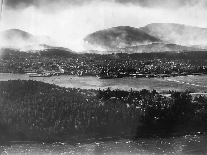 Bar Harbor with the mountains of Acadia behind it, after fire passed through in 1947.