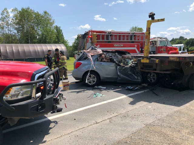 A passenger car was reported to have collided with the rear end of a flatbed trailer on Augusta Road in Winslow at about 1 p.m. Friday. The Winslow Fire Department was one of the first responders at the scene.