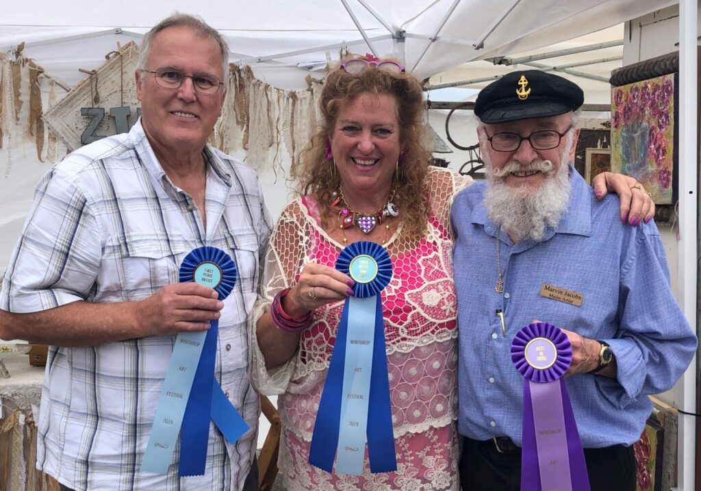 Winthrop Sidewalk Festival winners from left are painter Paul Boucher, of Lewiston, who won Best Fine Artist; Tinalyn Caisse ,of Winthrop, who won Best Fine Crafts; and painter Marvin Jacobs, of Belmont, who won Best in Show.