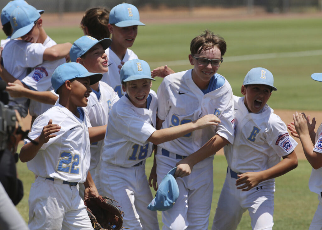 Louisiana Conner Perrot (99), center, celebrates with Will Andrade (18) along with Stan Wiltz (22), left, and Peyton Spadoni (1), right, following their 6-2 win over Texas West at the Southwestern Little League baseball regional championship game on Aug. 7.