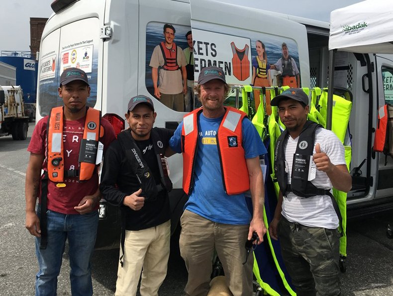 Lobstermen, from left, Salomon Tamup, Humberto Cach, Chris Chase and Josue Ruiz try life jackets in New Bedford, Massachusetts.